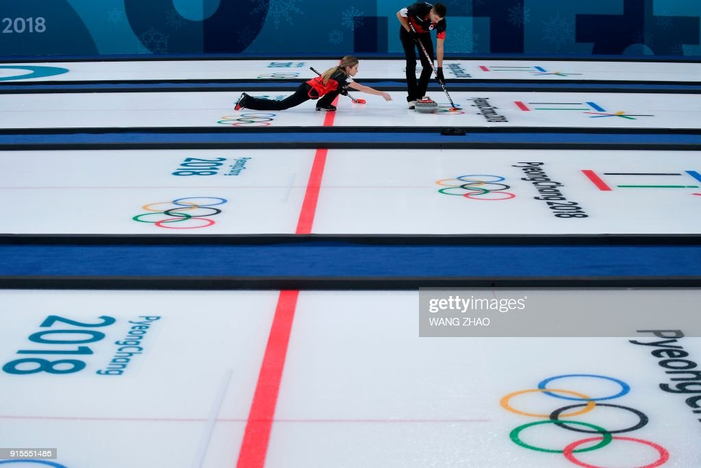 Canada's Kaitlyn Lawes throws the stone during the curling mixed doubles round robin session between Canada and Norway during the Pyeongchang 2018 Winter Olympic Games at the Gangneung Curling Centre in Gangneung on February 8, 2018. / AFP PHOTO / WANG Zhao