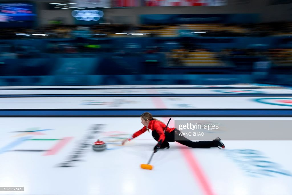 TOPSHOT - Canada's Kaitlyn Lawes throws the stone during the curling mixed doubles semi-final during the Pyeongchang 2018 Winter Olympic Games at the Gangneung Curling Centre in Gangneung on February 12, 2018. / AFP PHOTO / WANG Zhao