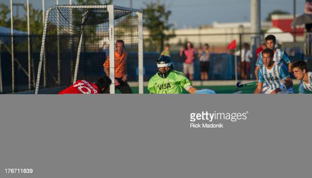 BRAMPTON ON AUGUST 17 Canada's Keegan Pereira has a shot on the keeper for Argentina Juan Vivaldo Mens Pan American Cup final between Canada and...