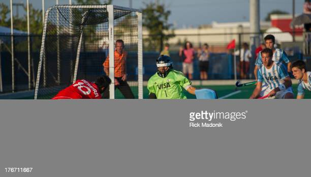 Canada's Keegan Pereira has a shot on the keeper for Argentina, Juan Vivaldo. Mens Pan American Cup final between Canada and Argentina, in Brampton,...