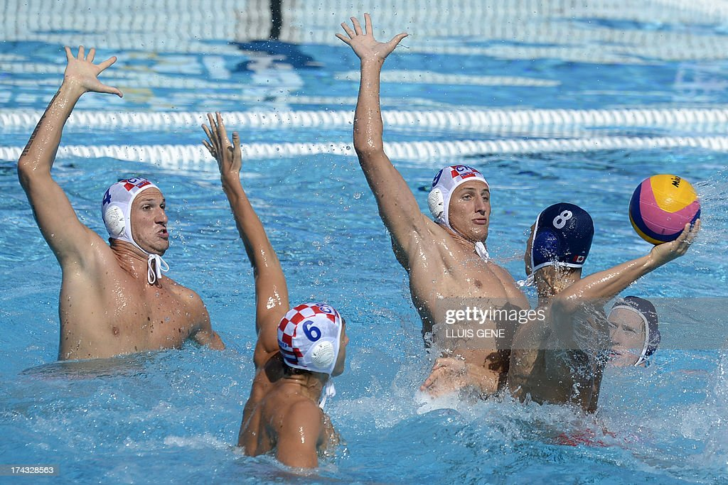 Canada's Kevin Graham (R) vies with (L to R) Croatia's Fran Paskvalin and Croatia's Sandro Sukno during the preliminary round match of the men's water polo competition between Croatia and Canada at the FINA World Championships at the Bernat Picornell swimming pool in Barcelona on July 24, 2013.