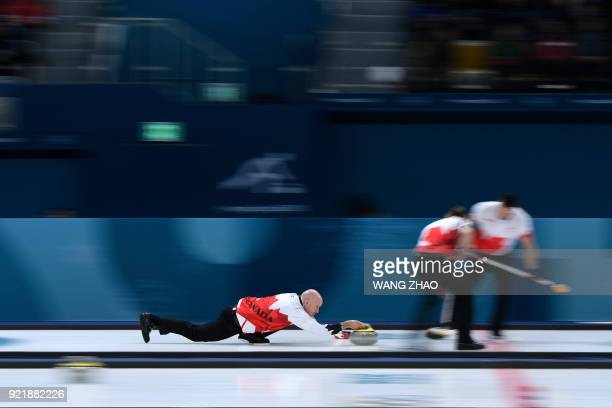 Canada's Kevin Koe throws the stone during the curling men's round robin session between Denmark and Canada during the Pyeongchang 2018 Winter...