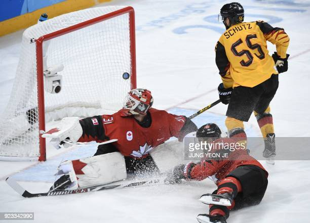 TOPSHOT Canada's Kevin Poulin looks on as a goal is scored in the men's semifinal ice hockey match between Canada and Germany during the Pyeongchang...