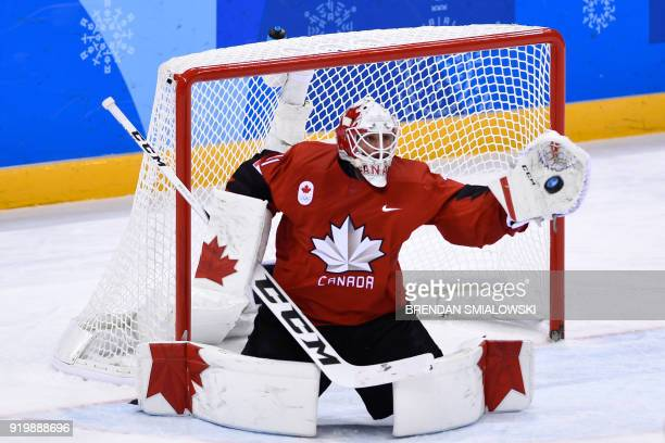 Canada's Kevin Poulin makes a save in the men's preliminary round ice hockey match between Canada and South Korea during the Pyeongchang 2018 Winter...