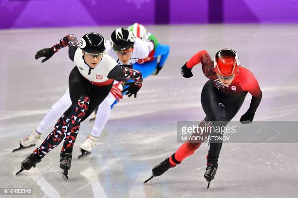 Canada's Kim Boutin leads in the women's 500m short track speed skating heat event during the Pyeongchang 2018 Winter Olympic Games, at the Gangneung...