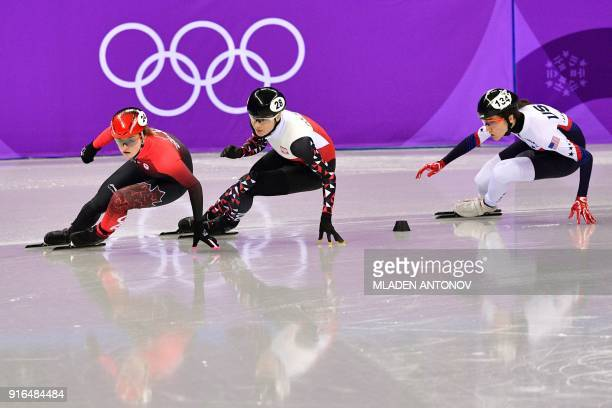 Canada's Kim Boutin , Poland's Natalia Maliszewska and USA's Lana Gehring take part in the women's 500m short track speed skating heat event during...
