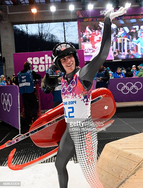 Canada's Kimberley Mcrae salutes after her run 3 in the Women's Luge Singles event of the Sochi Winter Olympics on February 11 2014 at the Sanki...