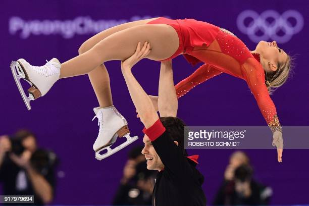 Canada's Kirsten MooreTowers and Canada's Michael Marinaro compete in the pair skating short program of the figure skating event during the...