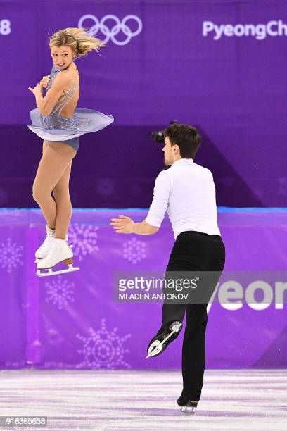 Canada's Kirsten MooreTowers and Canada's Michael Marinaroa compete in the pair skating free skating of the figure skating event during the...