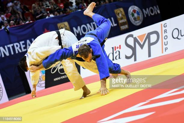 Canada's Kyle Reyes is battling KarlRichard Frey from Germany during the Final block of the judo Grand Prix at the MauriceRichard Arena on July 7...