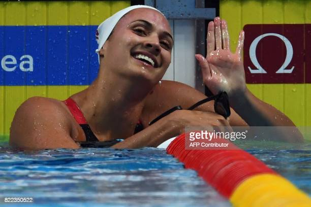 Canada's Kylie Jacqueline Masse celebrates a new world record after the women's 100m backstroke final during the swimming competition at the 2017...