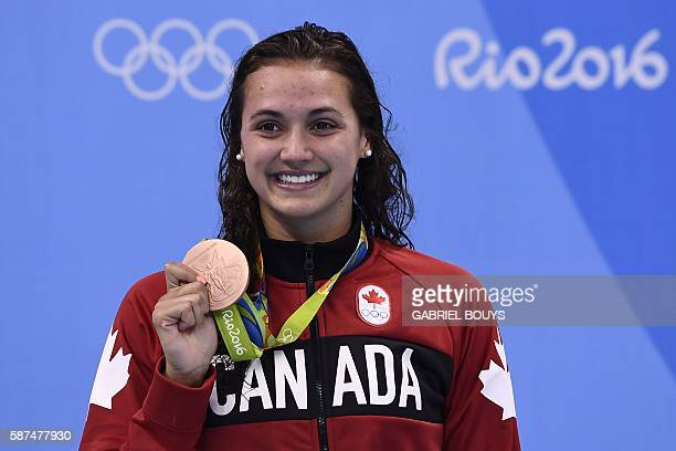 Canada's Kylie Masse poses with her bronze medal on the podium of the Women's 100m Backstroke during the swimming event at the Rio 2016 Olympic Games...