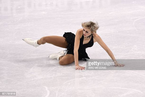 Canada's Larkyn Austman falls in the women's single skating short program of the figure skating event during the Pyeongchang 2018 Winter Olympic...