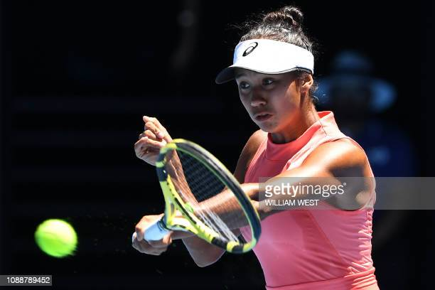 Canada's Leylah Annie Fernandez hits a return against Denmark's Clara Tauson during the girl's singles final on day 13 of the Australian Open tennis...