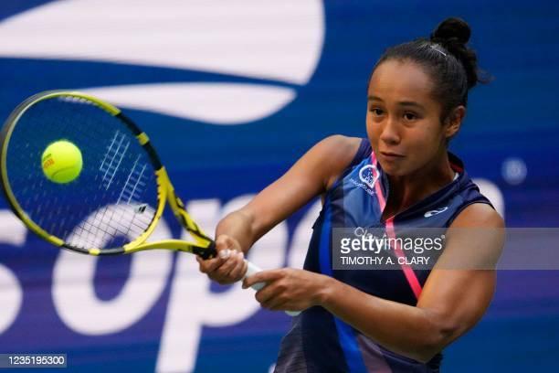 Canada's Leylah Fernandez hits a return to Britain's Emma Raducanu during their 2021 US Open Tennis tournament women's final match at the USTA Billie...