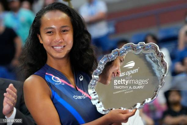 Canada's Leylah Fernandez poses with her runner-up trophy after losing the 2021 US Open Tennis tournament women's singles final match against...