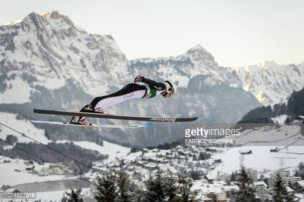 Canada's Mackenzie BoydClowes soars through the air during the men's FIS Ski Jumping World Cup competition in Engelberg central Switzerland on...