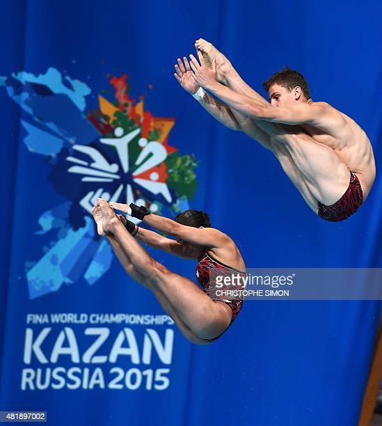 Canada's Maeghan Benfeito and Vincent Riendeau compete in the 10m platform synchronised mixed final diving event at the 2015 FINA World Championships...