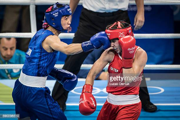 Canada's Mandy Bujold fought China's Cancan Ren in the women's fly 4851kg quarterfinal in Rio de Janeiro during the 2016 Rio summer Olympic Games...