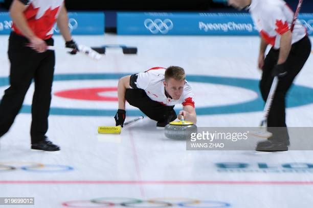 Canada's Marc Kennedy pushes the stone during the curling men's round robin session between Switzerland and Canada during the Pyeongchang 2018 Winter...