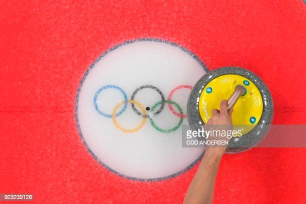 Canada's Marc Kennedy throws a stone during the curling men's bronze medal game during the Pyeongchang 2018 Winter Olympic Games at the Gangneung...