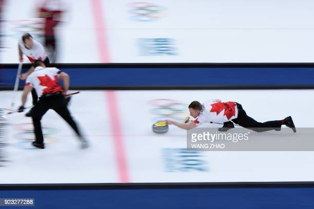 Canada's Marc Kennedy throws the stone during the curling men's bronze medal game during the Pyeongchang 2018 Winter Olympic Games at the Gangneung...