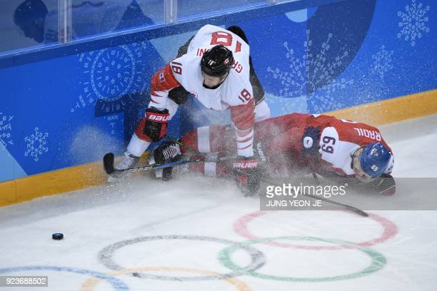 Canada's Marc-Andre Gragnani and Czech Republic's Lukas Radil fight for the puck in the men's bronze medal ice hockey match between the Czech...
