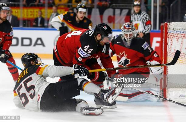 Canada's MarcEdouard Vlasic and Germany's Felix Schuetz vie during the IIHF Men's World Championship Ice Hockey quarterfinal match between Canada and...