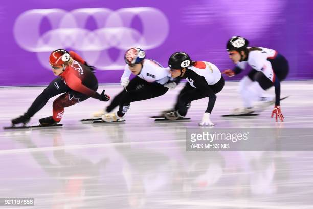 Canada's Marianne St Gelais South Korea's Kim Alang Japan's Sumire Kikuchi and USA's Lana Gehring compete in the women's 1000m short track speed...