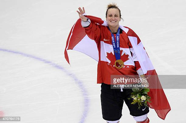 Canada's Marie-Philip Poulin celebrates with her gold medal during the Women's Ice Hockey Medal Ceremony at the Bolshoy Ice Dome plaza during the...
