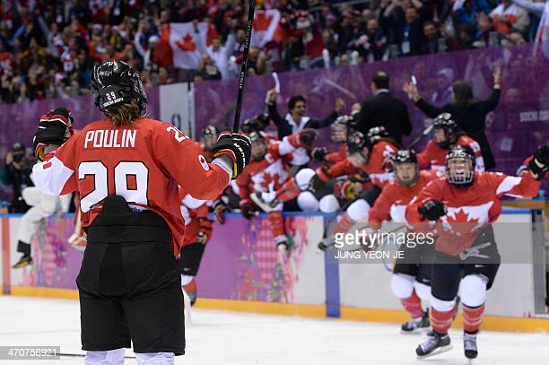 Canada's Marie-Philip Poulin celebrates with teammates after scoring and winning the Women's Ice Hockey Gold Medal Game between Canada and USA at the...