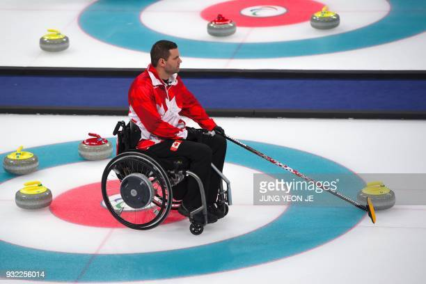 Canada's Mark Ideson competes in the wheelchair curling round robin session at the Gangneung Curling Centre during the Pyeongchang 2018 Winter...