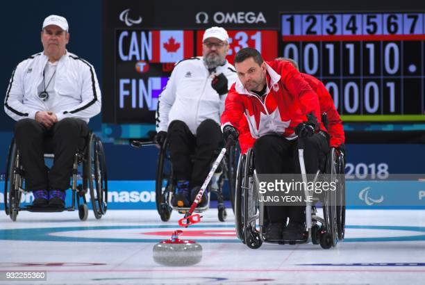 Canada's Mark Ideson pushes a stone during the wheelchair curling round robin session between Canada and Finland at the Gangneung Curling Centre...