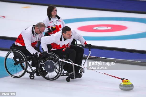 Canada's Mark Ideson pushes a stone during the wheelchair curling bronze medal game between South Korea and Canada at the Gangneung Curling Centre...