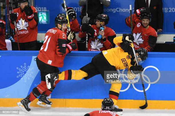 Canada's Mason Raymond and Germany's Timo Pielmeier collide in the men's semifinal ice hockey match between Canada and Germany during the Pyeongchang...
