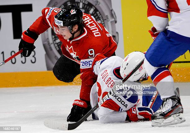 Canada's Matt Duchene vies for the puck with Norway's Henrik Solberg during the preliminary round match Canada vs Norway at the 2013 IIHF Ice Hockey...