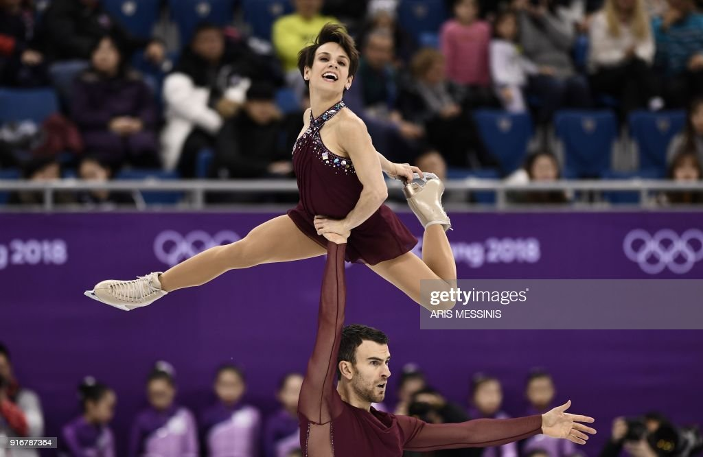 TOPSHOT - Canada's Meagan Duhamel and Canada's Eric Radford compete in the figure skating team event pair skating free skating during the Pyeongchang 2018 Winter Olympic Games at the Gangneung Ice Arena in Gangneung on February 11, 2018. /