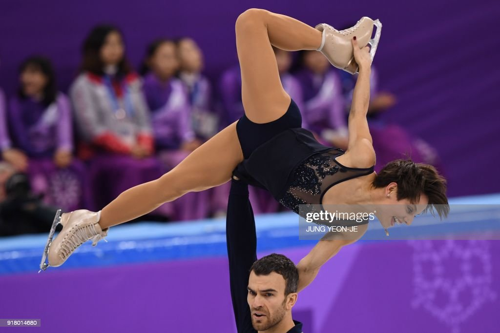 Canada's Meagan Duhamel and Canada's Eric Radford compete in the pair skating short program of the figure skating event during the Pyeongchang 2018 Winter Olympic Games at the Gangneung Ice Arena in Gangneung on February 14, 2018. / AFP PHOTO / JUNG Yeon-Je