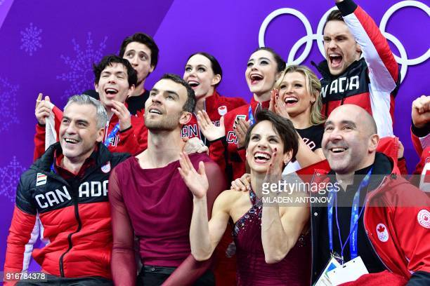 TOPSHOT Canada's Meagan Duhamel and Canada's Eric Radford react after competing in the figure skating team event pair skating free skating during the...