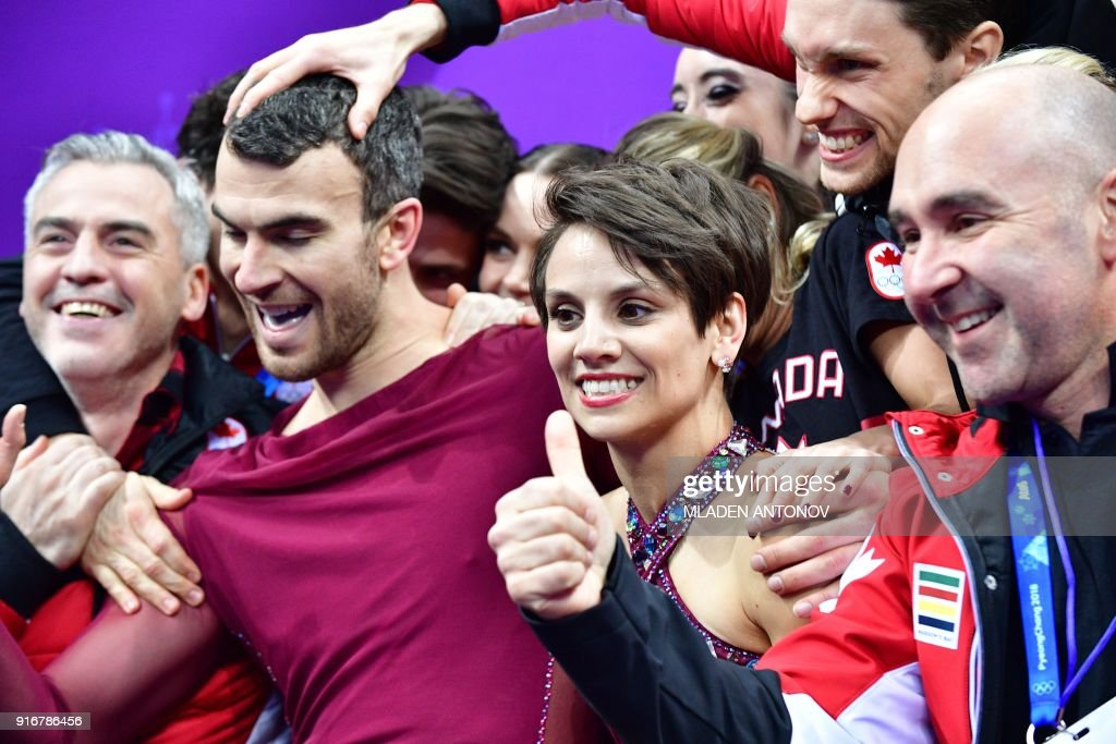 Canada's Meagan Duhamel (centre R) and Canada's Eric Radford (centre L) react after competing in the figure skating team event pair skating free skating during the Pyeongchang 2018 Winter Olympic Games at the Gangneung Ice Arena in Gangneung on February 11, 2018. / AFP PHOTO / Mladen ANTONOV
