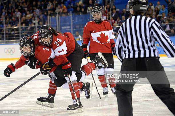 Canada's Meghan AgostaMarciano and Natalie Spooner celebrate after scoring a goal during the Women's Ice Hockey Group A match between Canada and USA...