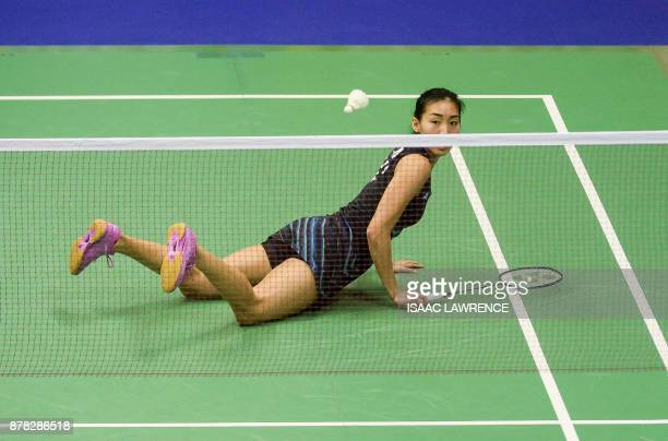 TOPSHOT Canada's Michelle Li eyes a return against Thailand's Ratchanok Intanon during their women's singles quarterfinal match at the Hong Kong Open...