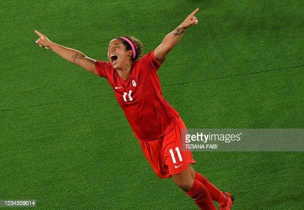 Canada's midfielder Desiree Scott celebrates winning the gold medal after the penalty shoot-out of the Tokyo 2020 Olympic Games women's final...