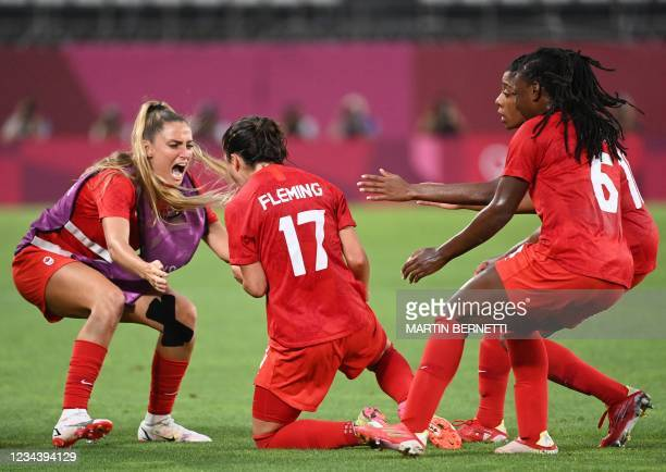 Canada's midfielder Jessie Fleming celebrates after scoring the opening goal during the Tokyo 2020 Olympic Games women's semi-final football match...
