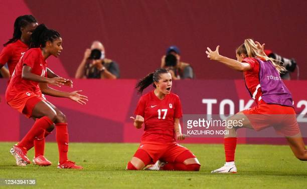 Canada's midfielder Jessie Fleming celebrates with teammates after scoring the opening goal during the Tokyo 2020 Olympic Games women's semi-final...
