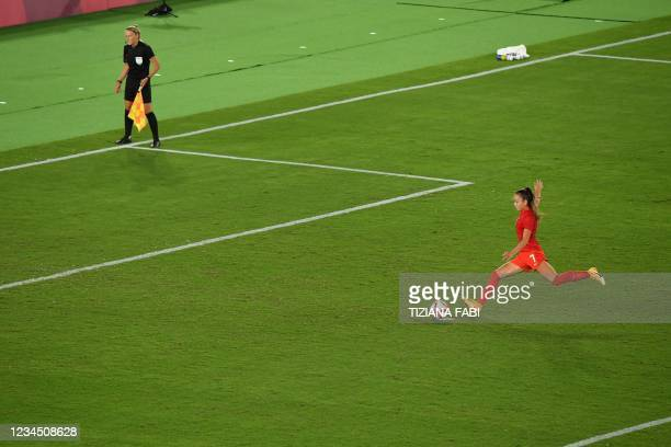 Canada's midfielder Julia Grosso shoot and score during the penalty shoot-out of the Tokyo 2020 Olympic Games women's final football match between...