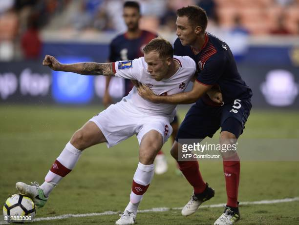 Canada's midfielder Scott Arfield fights for the ball with Costa Rica's defender Kenner Guiterrez during the Costa Rica vs Canada 2017 CONCACAF Gold...