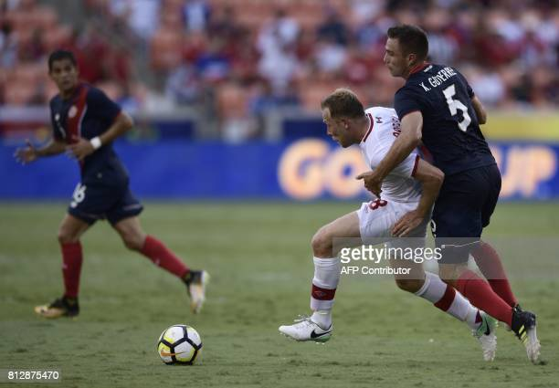Canada's midfielder Scott Arfield vies for the ball with Costa Rica's defender Kenner Guiterrez during a Group A match in the 2017 CONCACAF Gold Cup...
