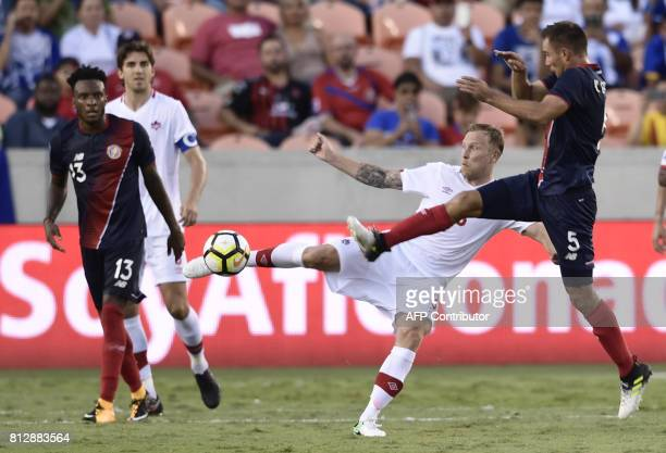 Canada's midfielder Scott Arfield vies for the ball with Costa Rica's defender Kenner Guiterrez during the Costa Rica vs Canada 2017 CONCACAF Gold...