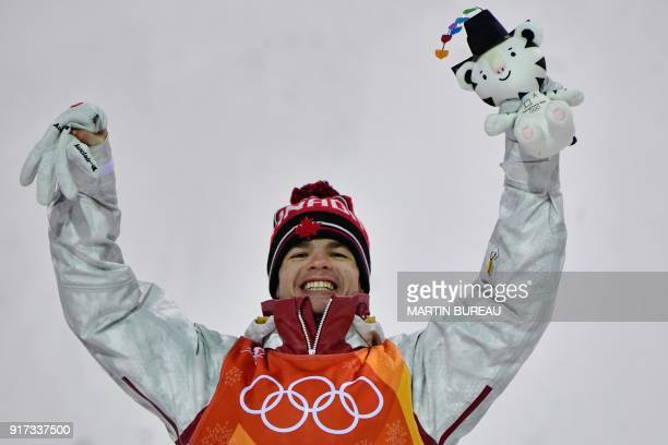 TOPSHOT Canada's Mikael Kingsbury celebrates on the podium during the victory ceremony after the men's moguls final during the Pyeongchang 2018...